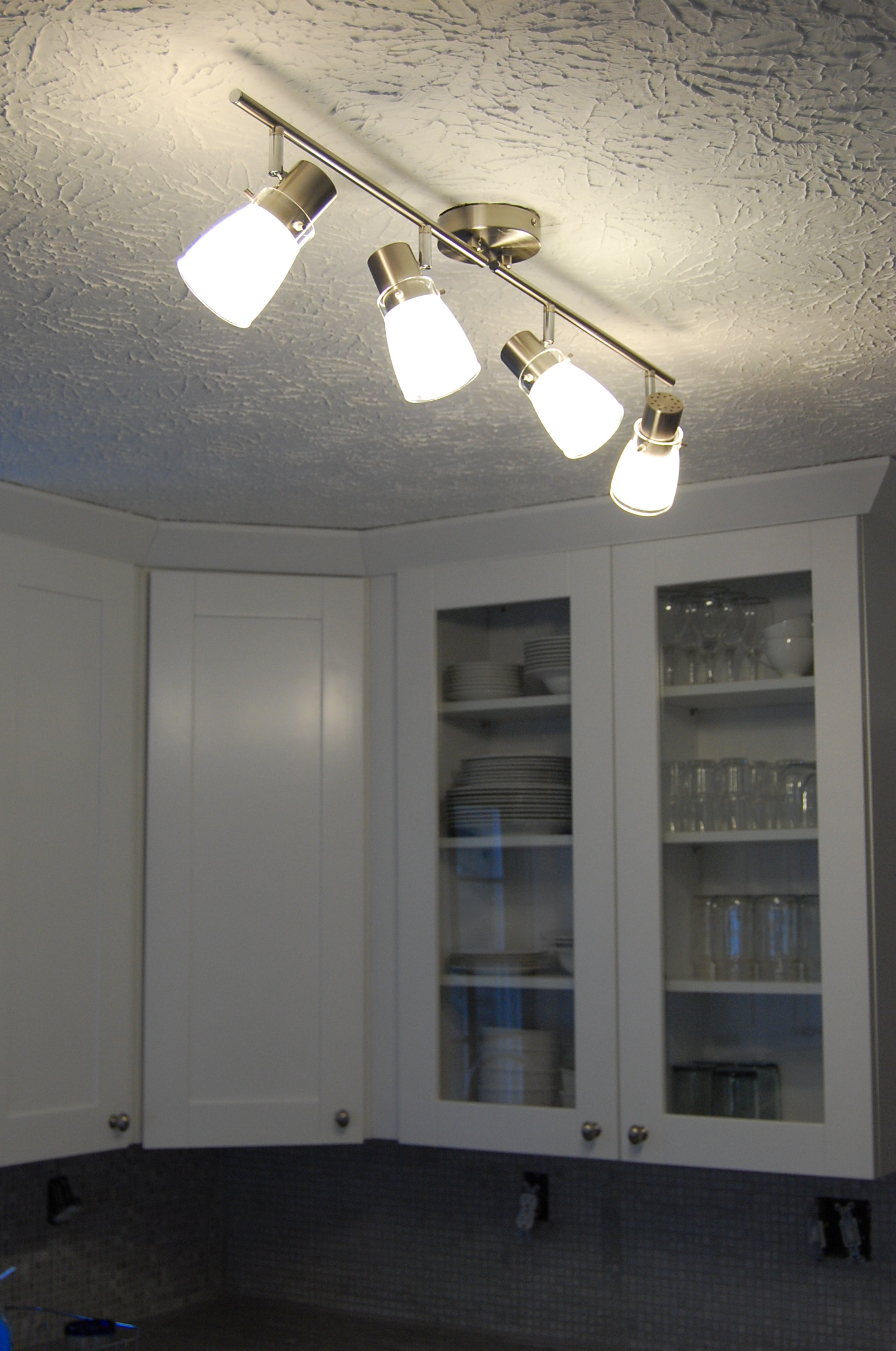 kitchen area i decided on a brushed nickel track lighting fixture